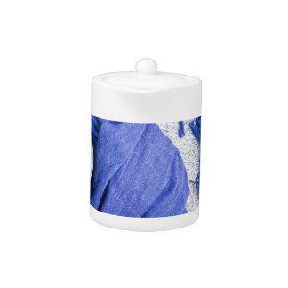 Blue scarf tied around the mug with hot coffee