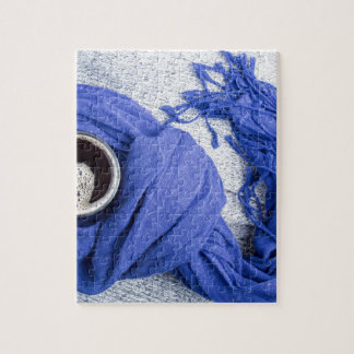 Blue scarf tied around the mug with hot coffee jigsaw puzzle