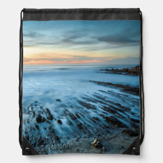 Blue seascape at sunset, California Drawstring Bags