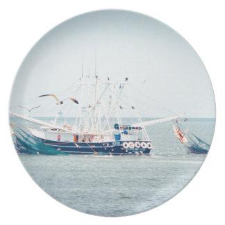 Blue Shrimp Boat on the Ocean Plate