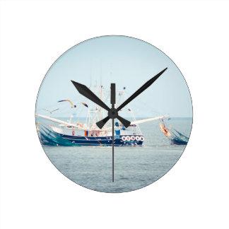 Blue Shrimp Boat on the Ocean Round Clock