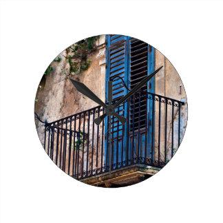 Blue Sicilian Door on the Balcony Round Clock
