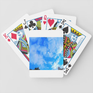 blue sky. bicycle playing cards