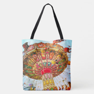 Blue sky retro vintage carnival swing ride photo tote bag
