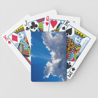 Blue sky with white clouds and ray of sunshine. bicycle playing cards
