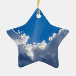 Blue sky with white clouds and ray of sunshine. ceramic ornament