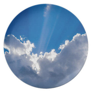 Blue sky with white clouds and ray of sunshine. plate