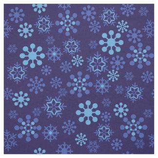 Blue snowflakes on dark blue background Fabric