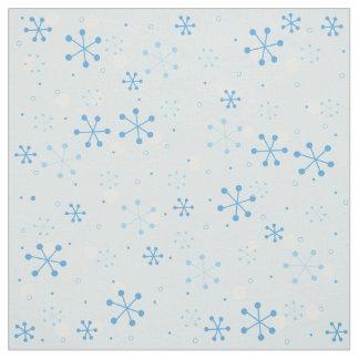 Blue snowflakes on dark white background Fabric