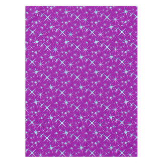 Blue snowflakes pattern on purple tablecloth