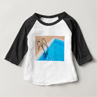 Blue swimming pool with ladder baby T-Shirt