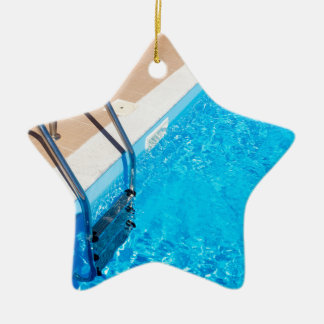 Blue swimming pool with ladder ceramic ornament