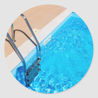Blue swimming pool with ladder classic round sticker