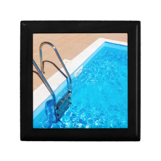 Blue swimming pool with ladder gift box
