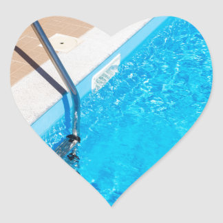 Blue swimming pool with ladder heart sticker