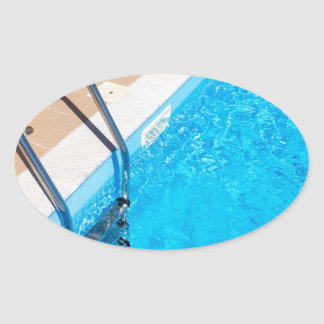 Blue swimming pool with ladder oval sticker