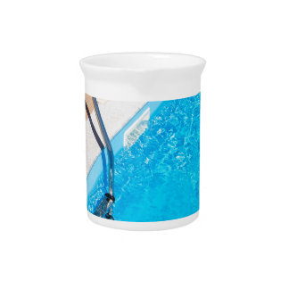 Blue swimming pool with ladder pitcher