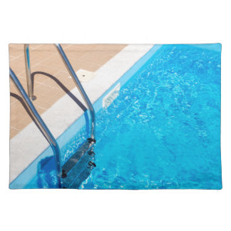 Blue swimming pool with ladder placemat