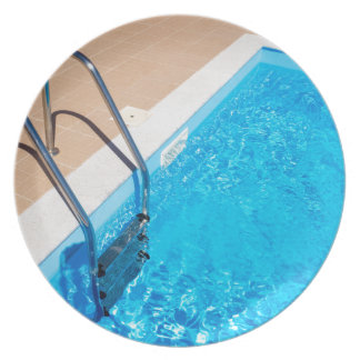 Blue swimming pool with ladder plate