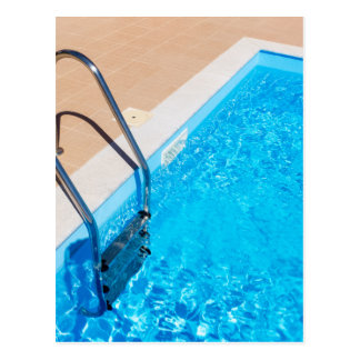 Blue swimming pool with ladder postcard