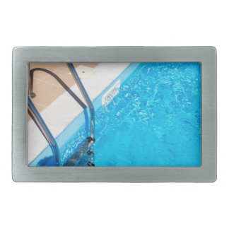 Blue swimming pool with ladder rectangular belt buckle