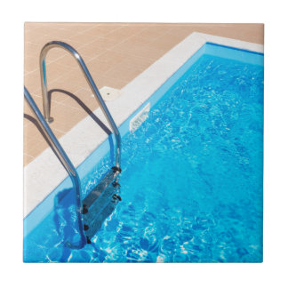 Blue swimming pool with ladder tile