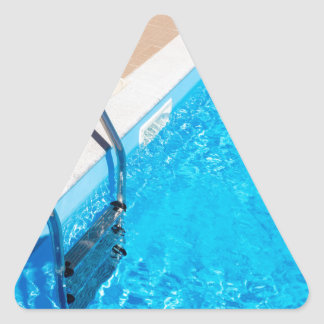 Blue swimming pool with ladder triangle sticker