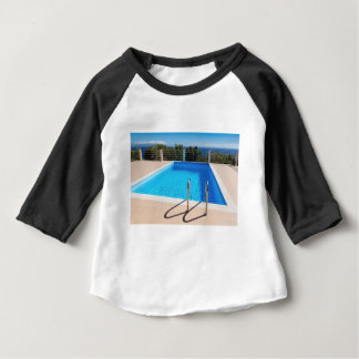 Blue swimming pool with steps at sea baby T-Shirt