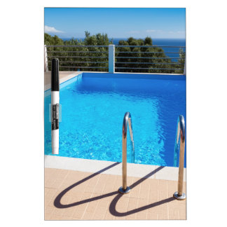 Blue swimming pool with steps at sea dry erase board