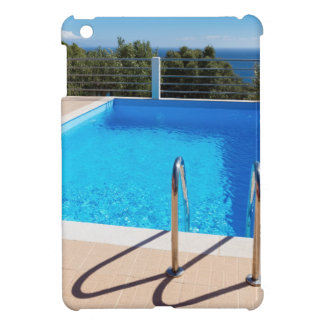 Blue swimming pool with steps at sea iPad mini covers