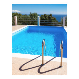 Blue swimming pool with steps at sea letterhead