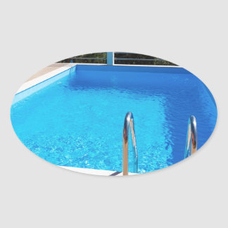 Blue swimming pool with steps at sea oval sticker