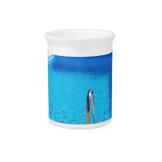 Blue swimming pool with steps at sea pitcher