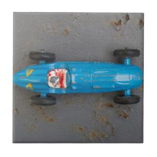 Blue toy car ceramic tiles