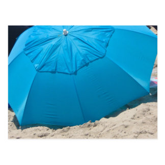 blue umbrella on the beach postcard