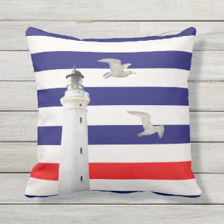 Blue white red nautical stripes and lighthouse throw pillow