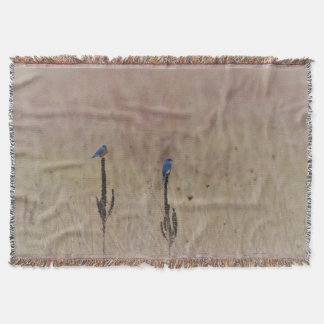 Bluebirds in a field throw blanket