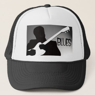 Blues player's silhouette with a spotlight trucker hat