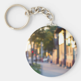 Blurred and out of focus image of streets basic round button keychain