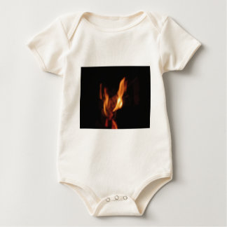 Blurred flames in a burning fireplace on black baby bodysuit