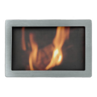 Blurred flames in a burning fireplace on black belt buckle