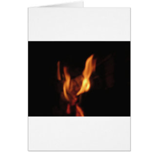 Blurred flames in a burning fireplace on black card