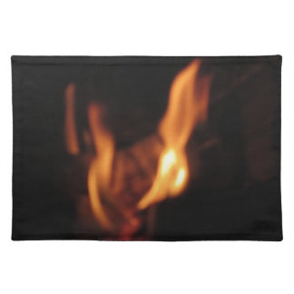 Blurred flames in a burning fireplace on black placemat