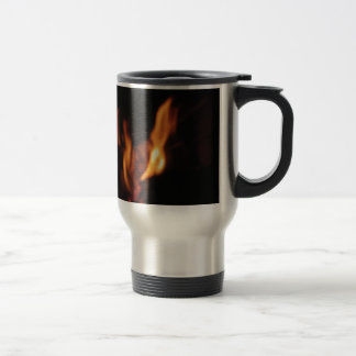 Blurred flames in a burning fireplace on black travel mug