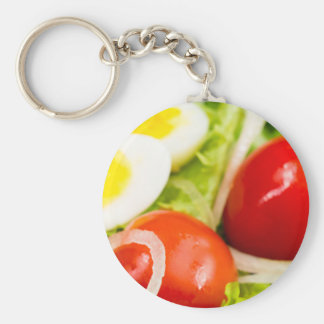 Blurred image of cherry tomatoes in a salad basic round button keychain