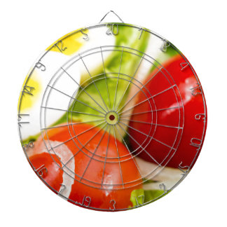 Blurred image of cherry tomatoes in a salad dartboard