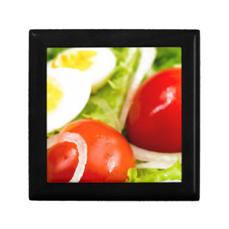 Blurred image of cherry tomatoes in a salad gift box