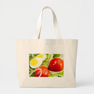 Blurred image of cherry tomatoes in a salad large tote bag
