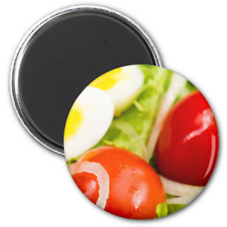 Blurred image of cherry tomatoes in a salad magnet