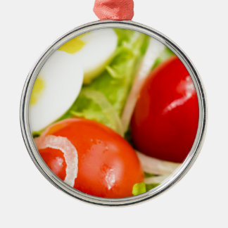 Blurred image of cherry tomatoes in a salad metal ornament